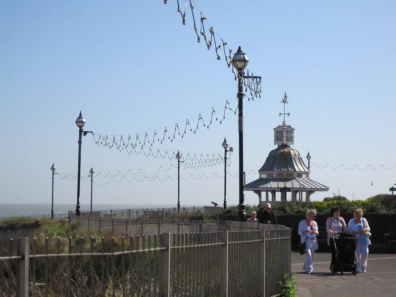 a stroll along the prom, where brass bands play ....