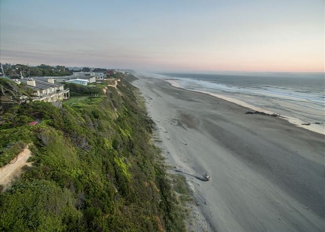 drone photo looking down to the beach from the home