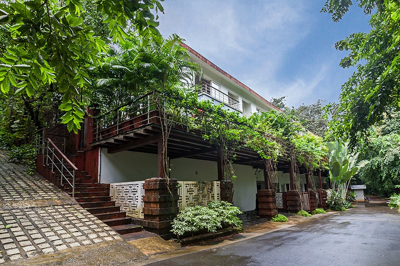 Full Villa exterior view with greenery