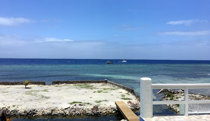 Dive boats just off shore at Airport Caves, where you can literally snorkel to right offshore.