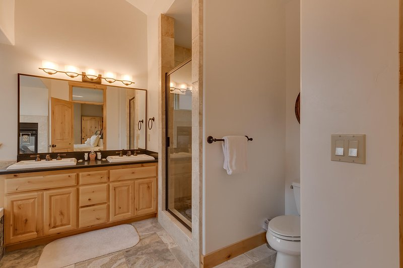 Evergreen Estate - Master bathroom with walk-in shower and dual sinks