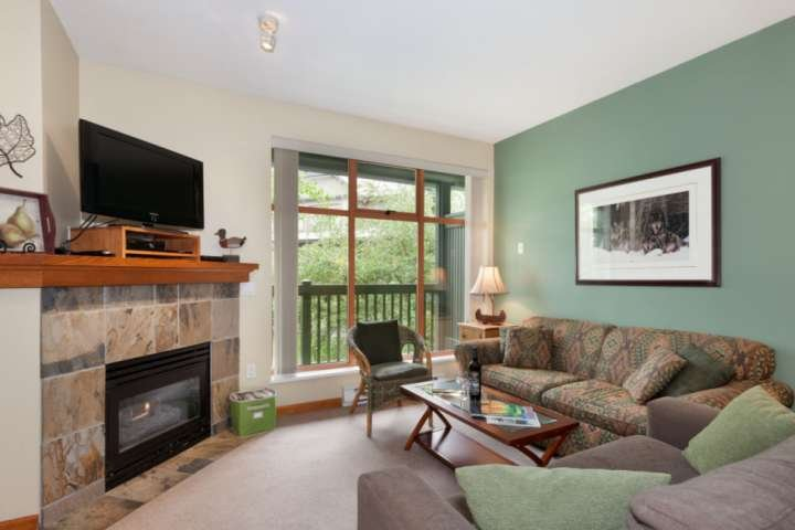 Bright living room with gas fireplace and plenty of comfortable seating