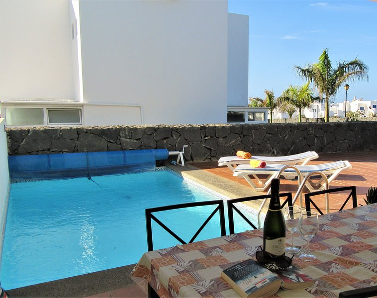 The villa has a private pool and always has areas for sun and shade all day