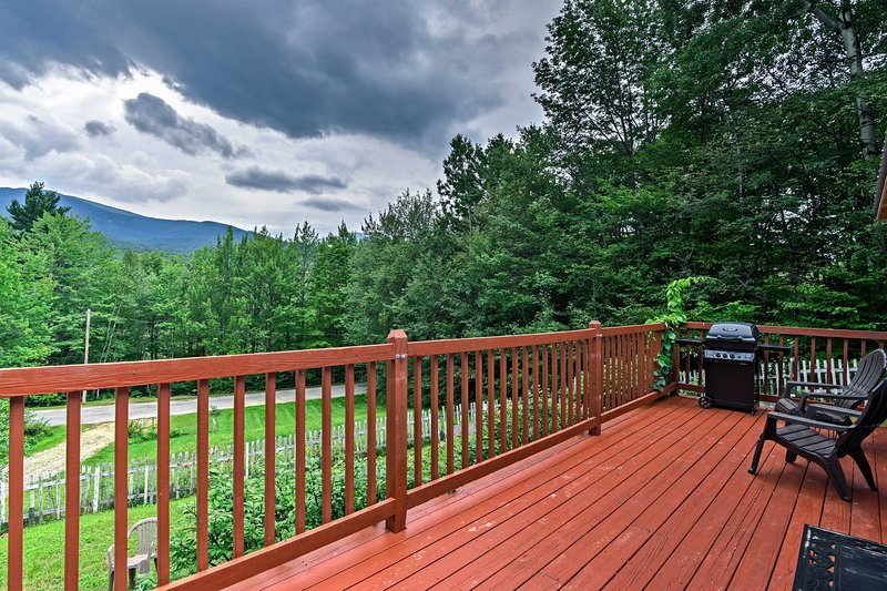 Admire the stunning mountain views from the large deck.