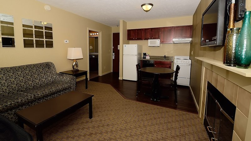 You will love the spacious and open living area, with fireplace, dining table and kitchen.