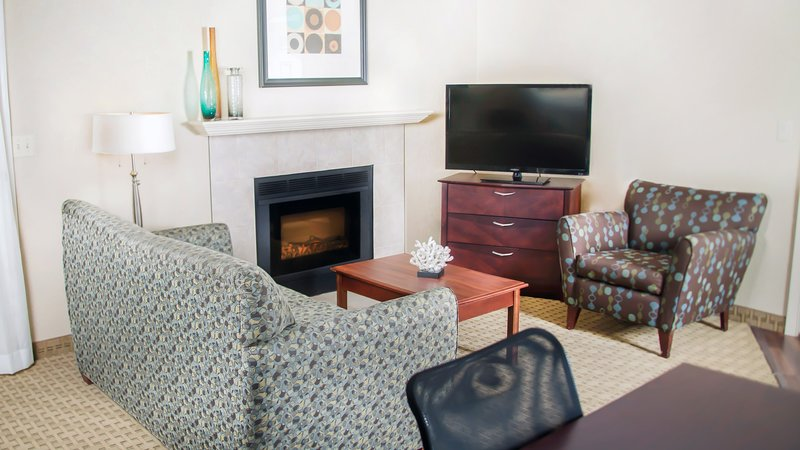Sit back in the cozy sitting area of our spacious and open suite.