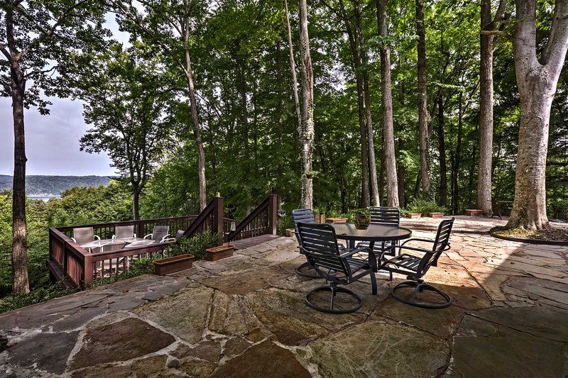 The house boasts spectacular lake views from the patio and multiple decks.