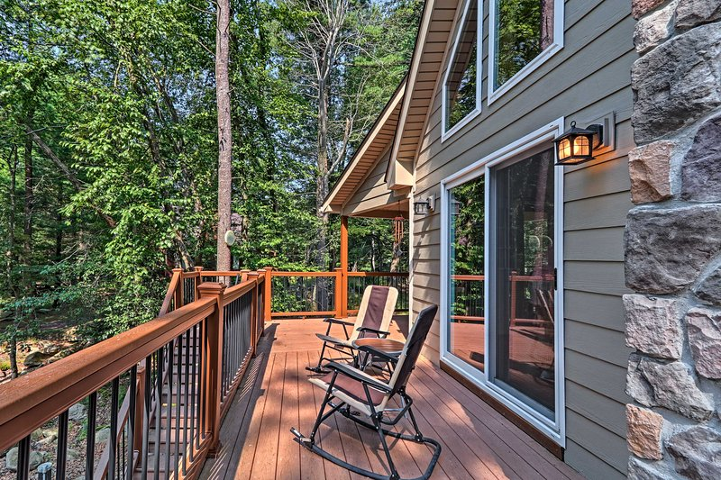 The expansive wraparound porch provides a peaceful place to relax and unwind.