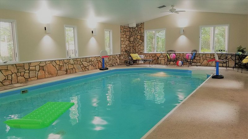 Heated indoor 16 x 32 feet pool. 3 feet by the steps to 5 feet at deep end.