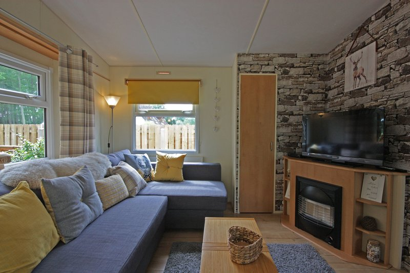 Woodlands, holiday rental in Tore