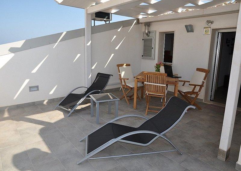 Appartamento Odisseo C, vacation rental in Punta Braccetto