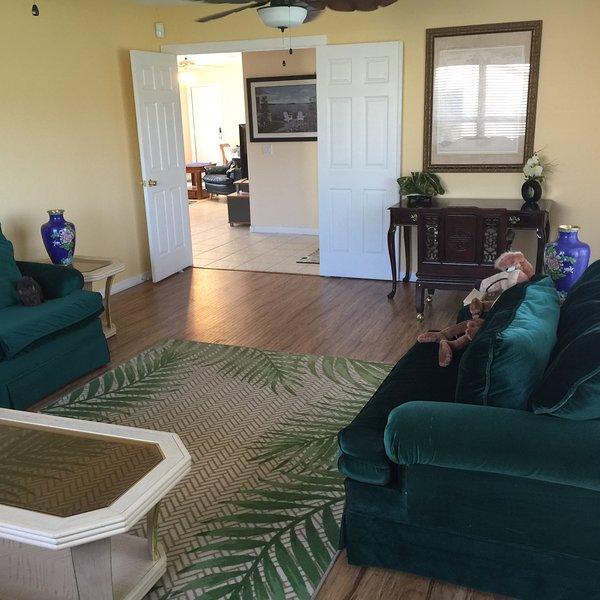 Living room with 3 comfy sofas and a writing desk
