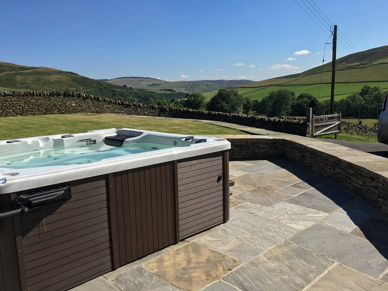 Time Hot tub, with a stunning view down the valley