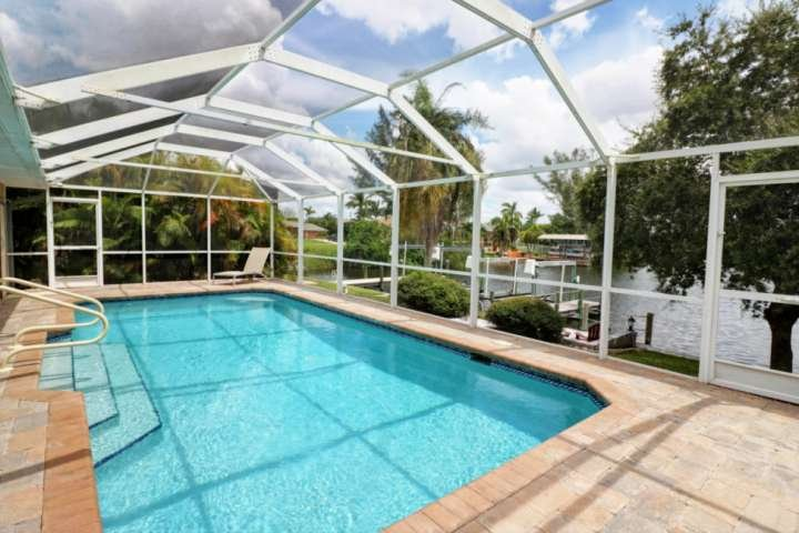 Get ready to live the ultimate Florida life! Your own private heated pool, boat lift, dock, and stunning view of canal leading to the Gulf!