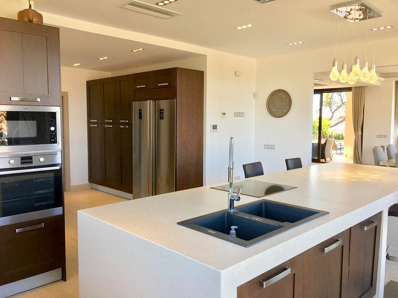 The big fully equipped kitchen with central island