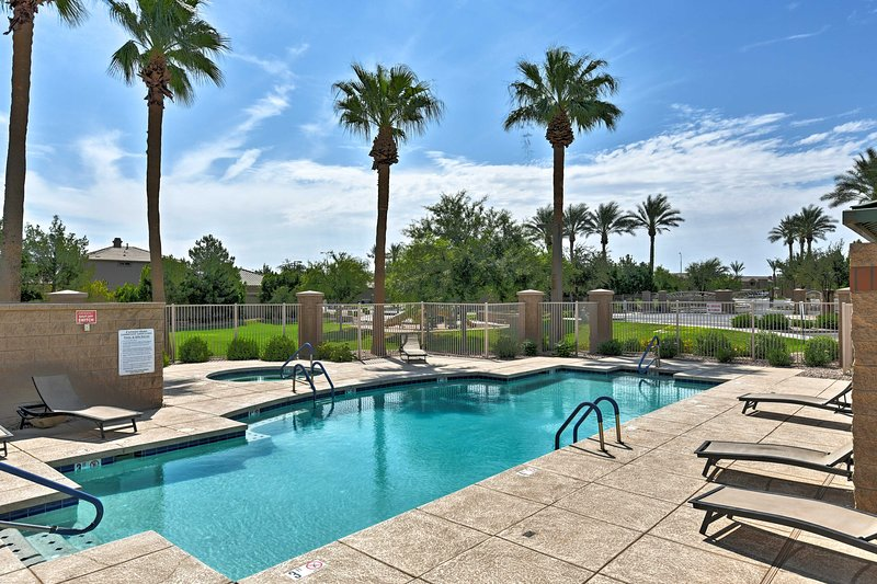 Come lounge by the pool at this Canyon Oaks community home in Chandler!