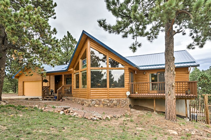 Escape into the mountains and stay at this 4-bedroom, 3-bath Westcliffe cabin.