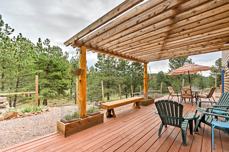 This vacation rental house sits on 5 private acres and boasts 3 decks.