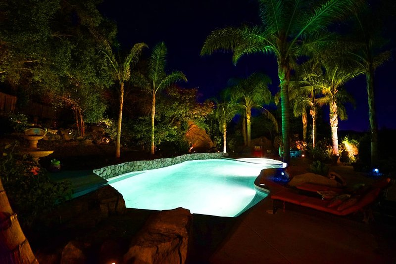 the pool looks so cool lit up at night