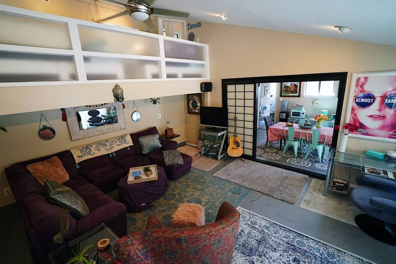 Large side of downstairs guest house... with couches and plenty of space to stretch or chill