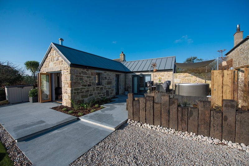 The outside space is perfect setting overlooking fields and St Michaels Mount to The Lizard.