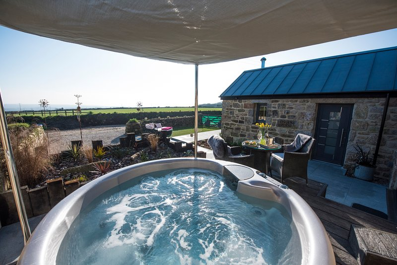 A beautiful barn conversion in an idyllic setting with private hot tub and fantastic views.