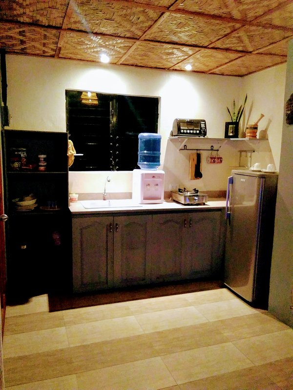 kitchen with refregerator , oven touster, free minirzl water and free to cook