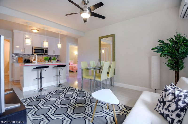 Full kitchen with a dining table to enjoy your family meals at.