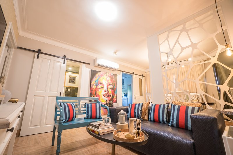 Arty, creative beautifully designed living room with 55 Inch Smart TV, Lounge Area and Dining Area