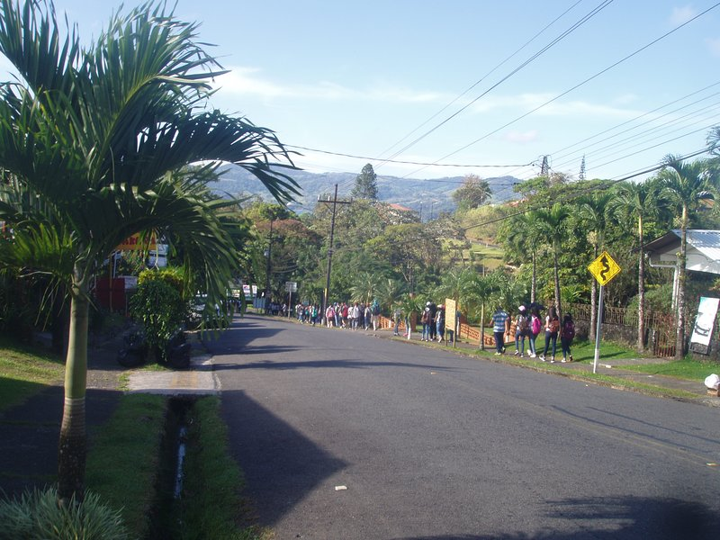 Marita's sidewalk view - School children walking to Nuevo Arenal Lake Park
