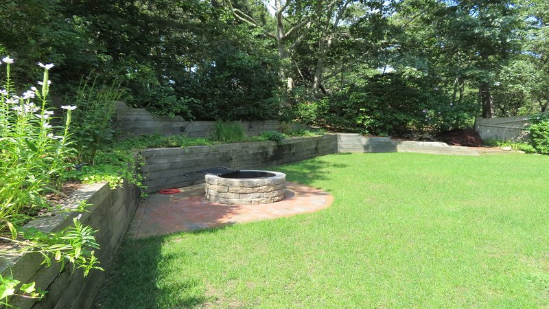 Built in Fire pit in the back yard-55 High Point Drive North Chatham Cape Cod - New England Vacation Rentals