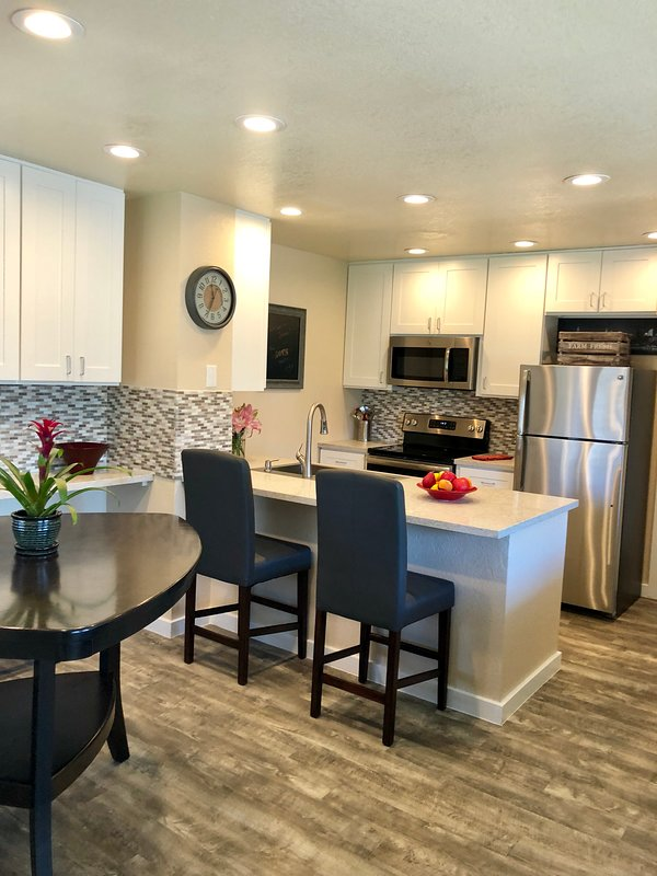 Beautiful kitchen open to great room and patio with grill...perfect for entertaining.