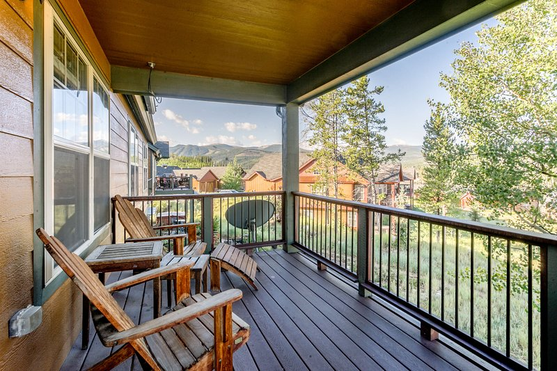 Main level deck with Adirondack chairs and views of the slopes