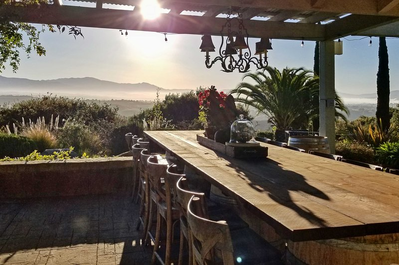 Dine al fresco with vineyard views.
