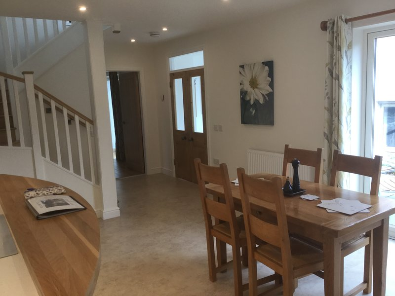 The original double doors lead into the open plan hallway and kitchen dining area