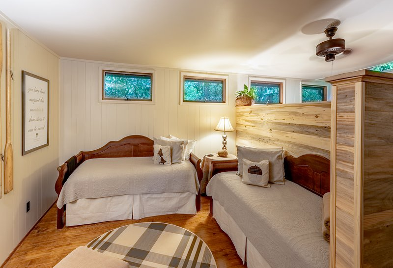 The sleeping lodge has two sections; the daybed area and the queen bed area.