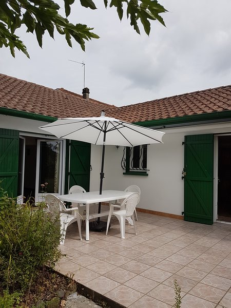 Patio accessed from kitchen and sitting room