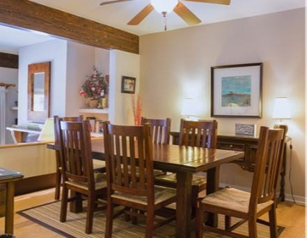 Share delicious meals at the dining table with seating.