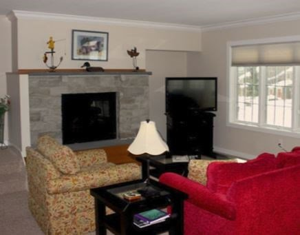 Sit back in front of the gas fireplace in the living room.