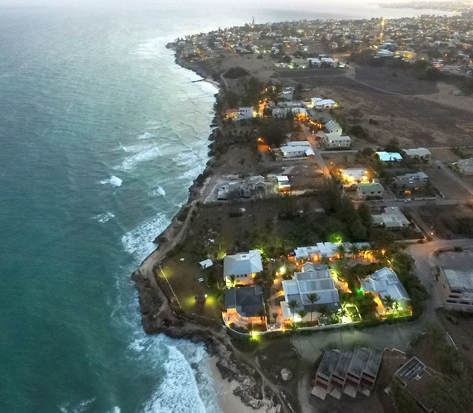 Aerial view of the Inchcape Seaside Villas at sunset