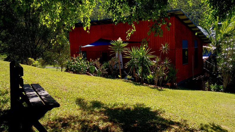 Cosy Cottage, adjacent to the main retreat building, with private garden and outdoor seating area.