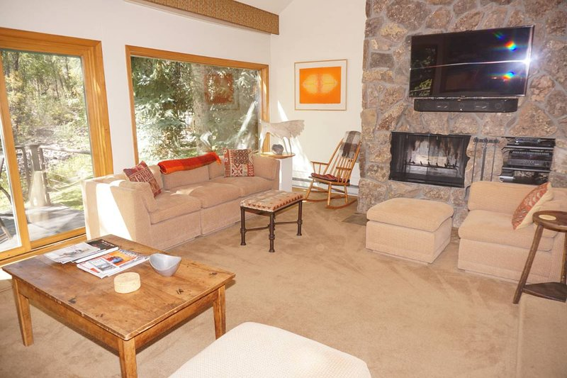 Living Room with Large Screen TV and Fireplace