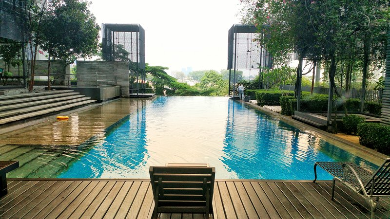 Outdoor infinity pool, children pool with landscape garden