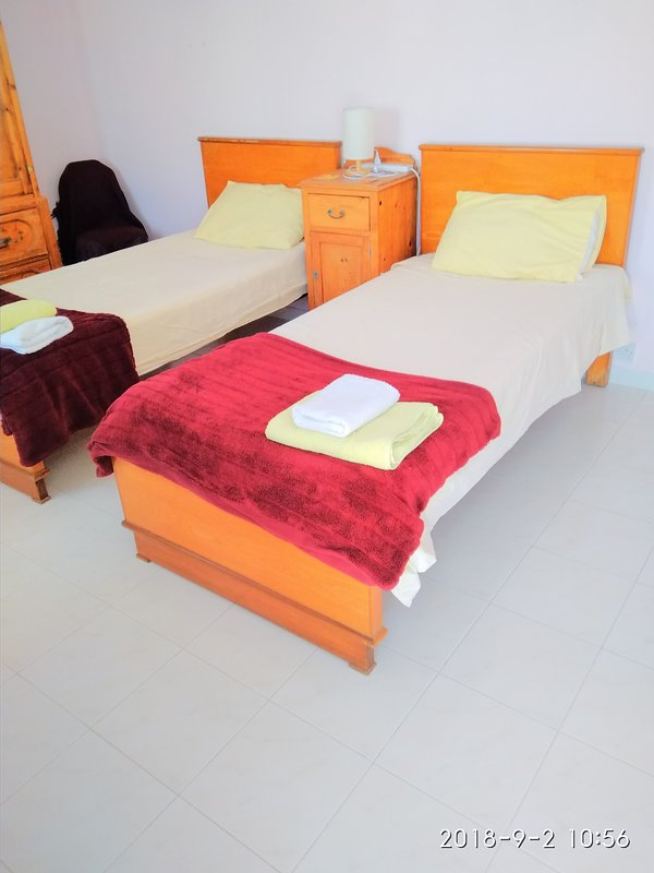 Cosy bedroom. Beds can be pulled up together to form a double bed on guests' requests.