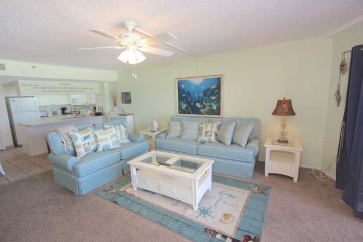 Oceanfront living room with sleeper sofa.