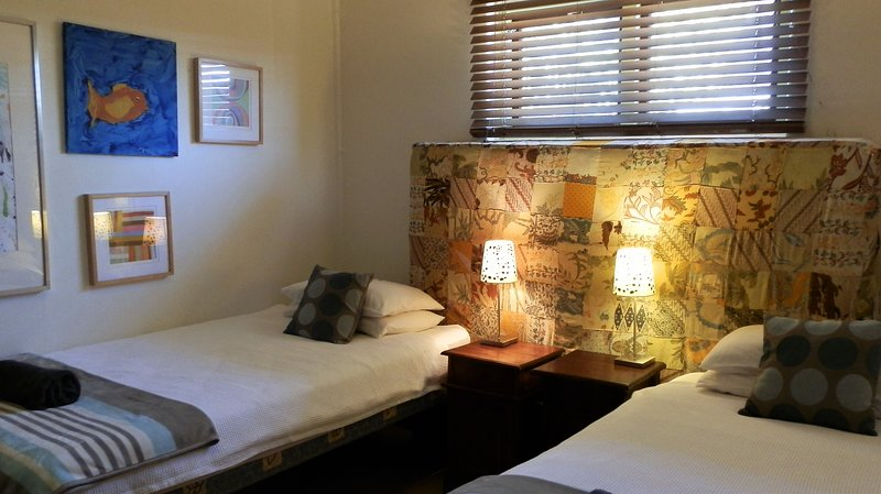 Two singles in the second bedroom can join to form a king bed if required