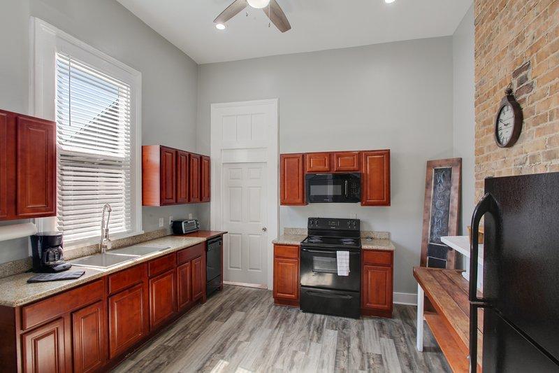 Full kitchen - door to bedroom 2.