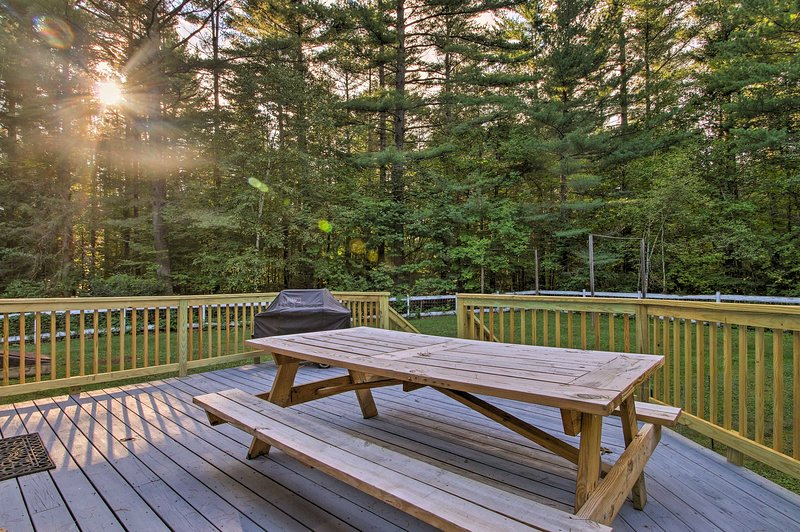You'll love spending time outdoors with this wraparound deck and gas grill.