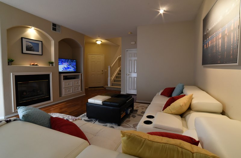 Main living space features modern Itailian white leather furntiture with cherry wood flooring.