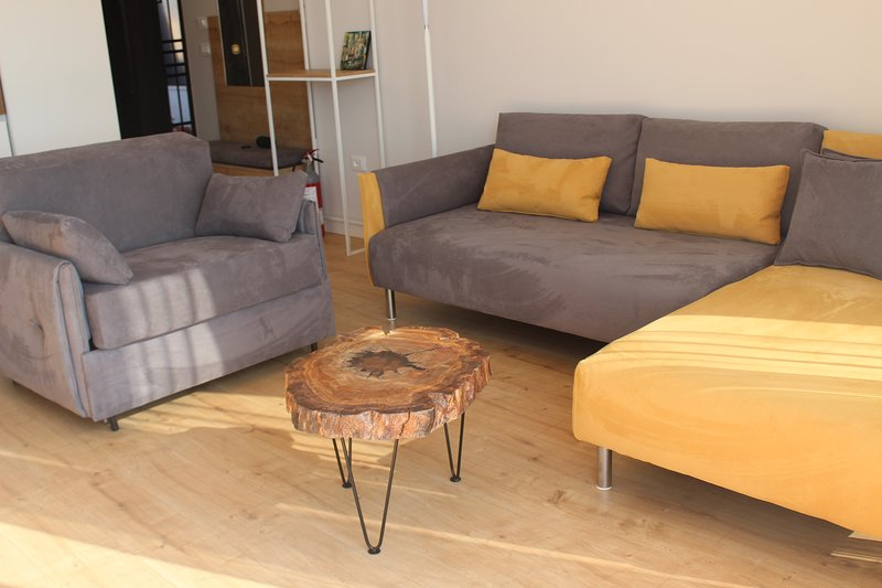 Neutral and warm colours offering a touch of nature at the living room